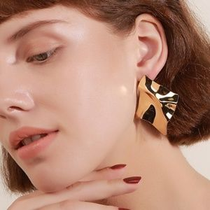 Gold toned abstract wrinkled stud earrings
